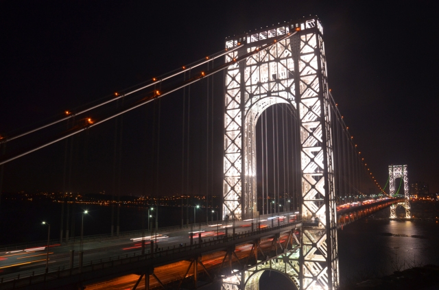 The George Washington Bridge lit in orange and green for Super Bowl XLVIII as seen from the Fort Lee Historic Park
